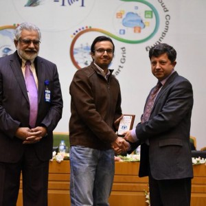 Syed Ahsan Raza Getting The Best Poster Award Of IEEE HONET 2015 From Dr. Ismail Shah (Chairman PTA) And Rector NUST