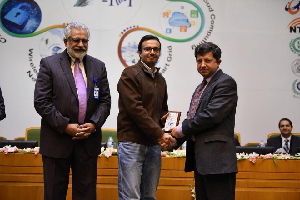 Syed Ahsan Raza Receiving The  Best Poster Award Of IEEE HONET From Dr. Ismail Shah (Chairman PTA) And Rector NUST (2015)